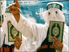 Islamic Terrorists Holding Qur'an, But Worry Not, It Has Nothing To Do With Islamic Terrorism